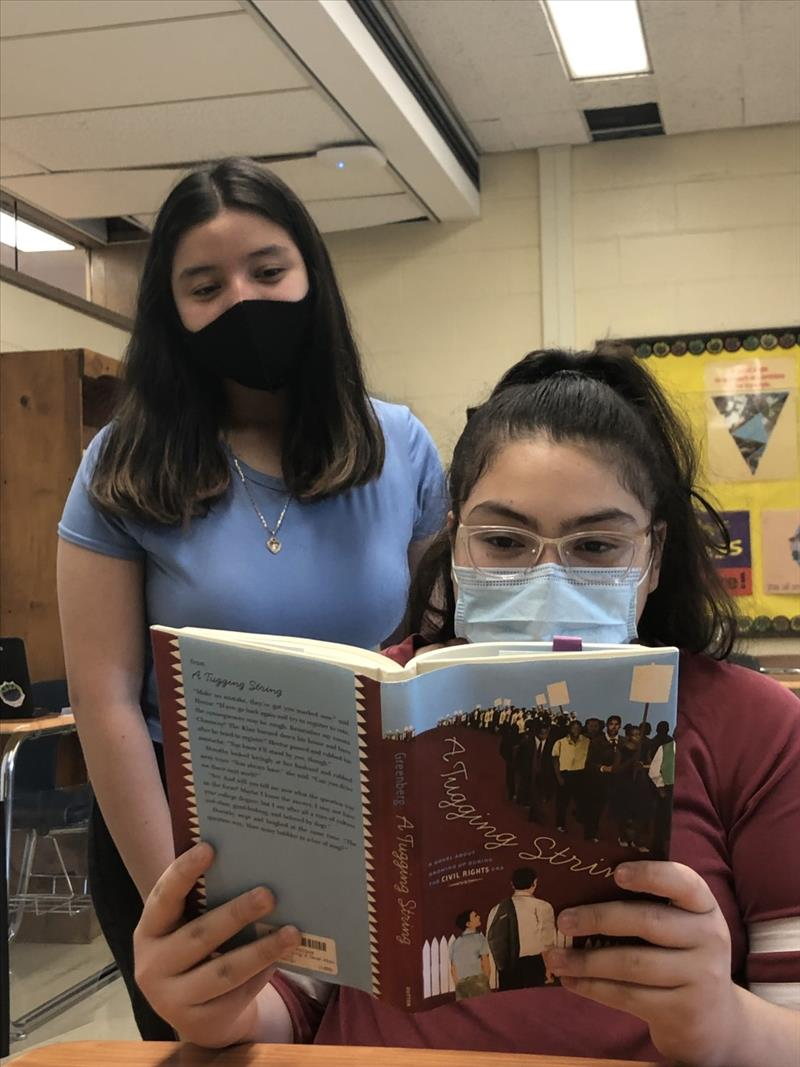 Photo of students reading book