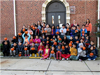 Students get festive with annual 'Pumpkin Day' photo